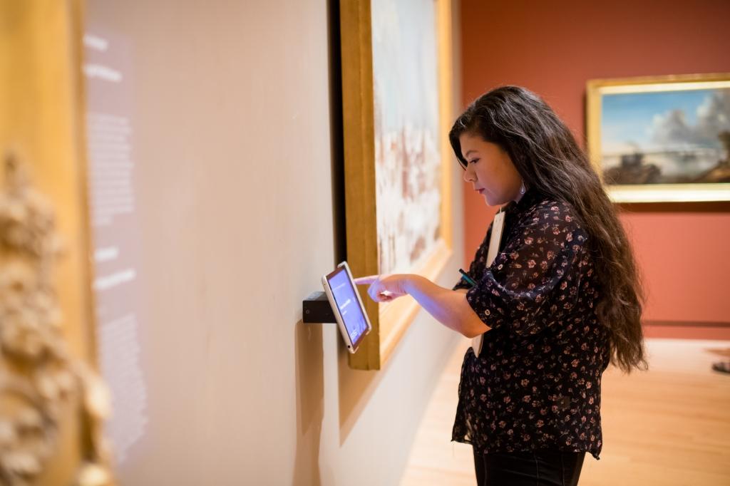 Girl using touchscreen in museum exhibit
